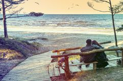 Happy couple are resting at sandy beach in Jurmala Royalty Free Stock Photography