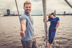 Happy couple resting on a yacht Stock Photography
