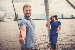 Happy couple resting on a yacht Stock Images