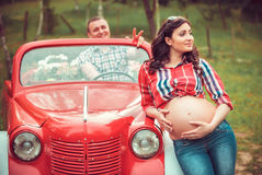 Happy couple in retro red car Royalty Free Stock Photos