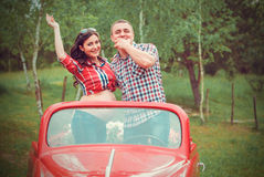Happy couple in retro red car Stock Image