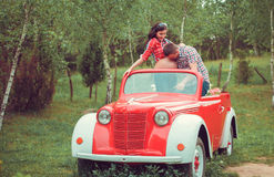 Happy couple in retro red car Stock Photos
