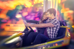 Happy couple ride bumper car Royalty Free Stock Images
