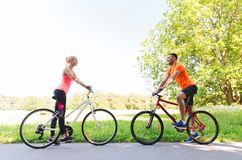 Happy couple riding bicycle outdoors Stock Images