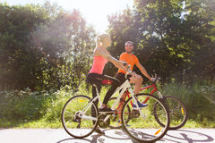 Happy couple riding bicycle outdoors Royalty Free Stock Image