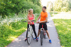 Happy couple riding bicycle outdoors Stock Image