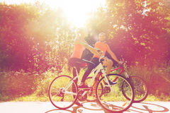 Happy couple riding bicycle outdoors Royalty Free Stock Photography