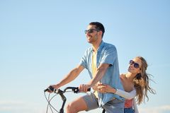 Happy couple riding bicycle together in summer Stock Photo