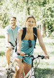 Happy couple riding bicycle Stock Image