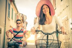 Happy couple riding bicycles outdoors Royalty Free Stock Images