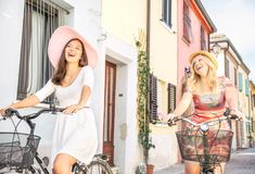 Happy couple riding bicycles outdoors Stock Image