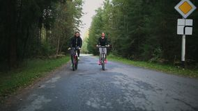 Happy couple riding bicycles outside, healthy lifestyle fun concept.  stock footage