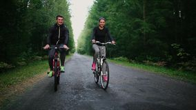 Happy couple riding bicycles outside, healthy lifestyle fun concept.  stock video footage