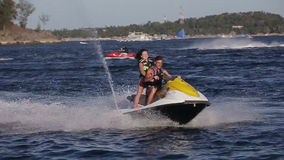Happy couple riding jet ski