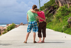 Happy couple on the road Stock Photo