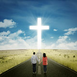 Happy couple on the road with a cross Stock Photos