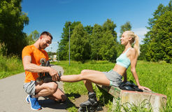 Happy couple with rollerblades outdoors Royalty Free Stock Image