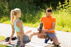 Happy couple with rollerblades outdoors Stock Image