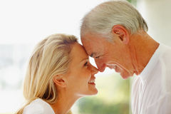 Happy couple romancing together at home Stock Photography