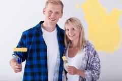 Happy couple during room renovation Stock Photo