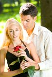 Happy couple with rose Stock Image