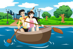Happy couple rowing a boat Stock Photos