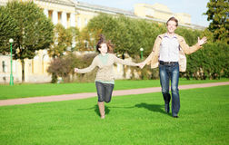 Happy couple running Stock Images