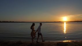Happy couple running on the beach stock video footage
