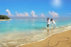 Happy couple running at beach royalty free stock image