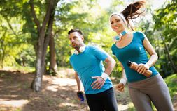 Happy couple running and exercising together outdoor royalty free stock photography