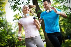 Happy couple running and exercising together outdoor royalty free stock photo