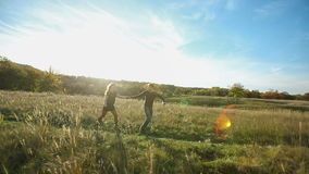 Happy Couple Running at Field. Happy Couple Running at sunset stock footage
