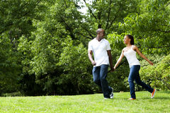 Happy Couple Running In Park Royalty Free Stock Image