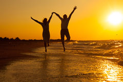 Free Happy Couple Running On The Beach Stock Image - 50640271
