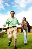 Happy couple running outdoors Royalty Free Stock Images