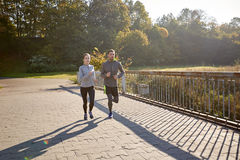 Happy couple running outdoors Stock Image