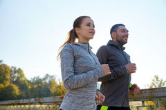 Happy couple running outdoors Royalty Free Stock Image