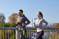 Happy couple running outdoors Stock Images