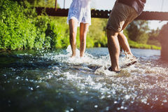 Happy couple running in shallow water. Stock Image