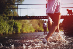 Happy couple running in shallow water. Royalty Free Stock Photos