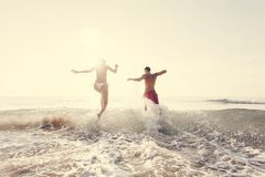 Happy couple running to the sea stock photos