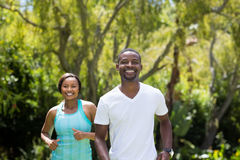 Happy couple running together Stock Photo