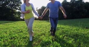 Happy couple running together stock video footage