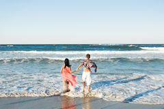 Happy Couple Running on Tropical Beach, Vacation Royalty Free Stock Photos