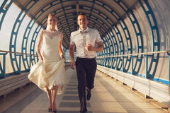 Happy couple running in tunnel Royalty Free Stock Photography