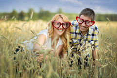Happy couple in rye field Royalty Free Stock Photos