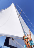 Happy couple on sailboat Stock Image