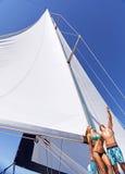 Happy couple on sailboat Stock Image