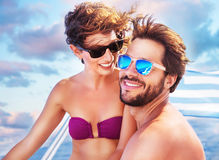 Happy couple on sailboat Stock Images