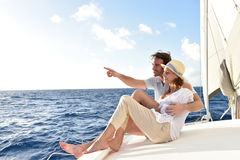 Happy couple on a sailing boat enjoying Stock Photography